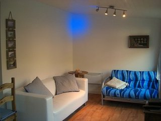 Stylish living room in ocean themed colours
