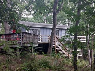 surrounded by woods you'll feel as if you're staying in a tree house