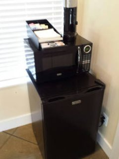 Refrigerator with microwave and  K-cup coffee maker with a variety of coffees and creamers
