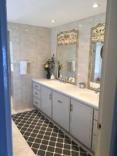 Floor to ceiling tiles and lovely mirrors create a fabulous ambience and walk in shower complete it