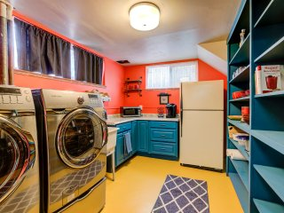 Who can't love a kitchenette with a yellow floor, open shelving, and laundry!?