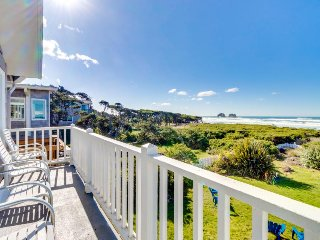 Dog-friendly beachfront home w/game room, firepit, private deck, sweeping views