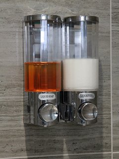 Easy to use push button shower gel and shampoo dispensers