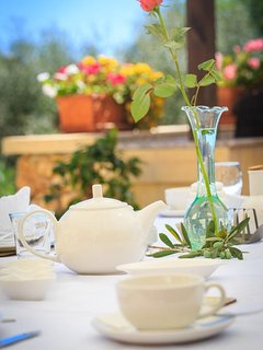 Breakfast table and flowers
