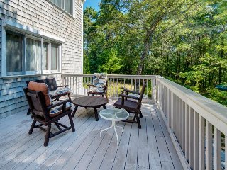 Enchanting family home w/deck overlooking a large backyard, near fun attractions