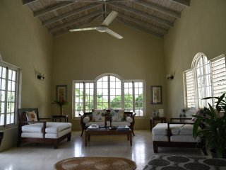 Our large sitting room with vaulted ceiling allowing  wonderful cooling breezes to pass through.