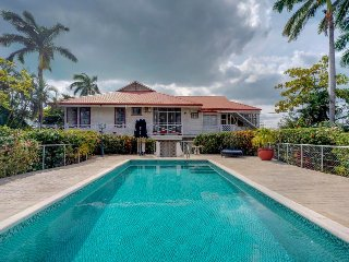 Breezy cottage with shared pool moments from the ocean and city sights!