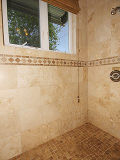All four bathrooms have tiled showers