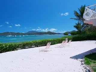 The view from your private beach looks down Coral Bay and over to Tortola and Round Bay (2017 photo showing old pool railings)