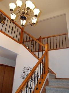 Elegant open stairway design overlooks the main level