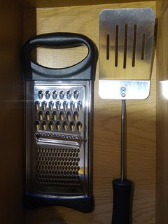 Cheese grater, and metal spatula