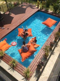 guest enjoy swimming pool.