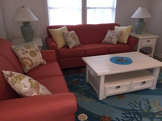 couch, loveseat and rocker makes a cozy place to watch tv, read, or relax with guests.