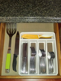 Metal spatula, large knife, small knife, and silverware