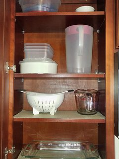 Storage containers, water pitcher, strainer, measuring cup, and baking pan