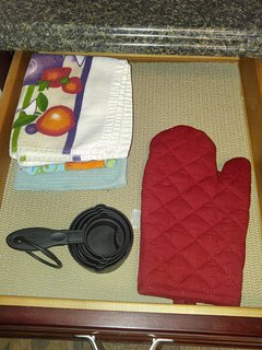 Kitchen towels, measuring cups, and hot pads