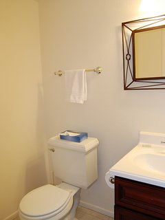Lower level bathroom features a tile floor