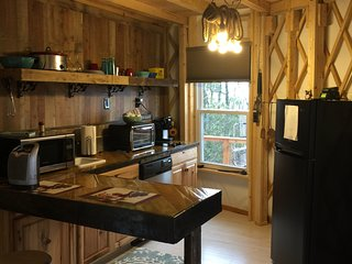 yurt with full kitchen.  Stove top, microwave, oven, kuerig coffee maker, crockpot, and refridge.