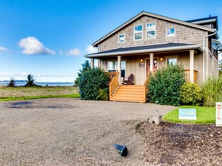 Enjoy the bay from the front deck or the back patio of this great bayfront home