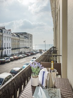 Relax on the balcony and watch the world go by