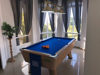 Free play Supreme pool table, over looking swimming pool and garden