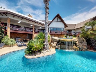 Gorgeous home w/ two private pools, deck & sea views - close to golf & the beach