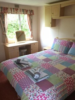 Double bedroom with luxurious goose and down mattress topper, duvet and pillows