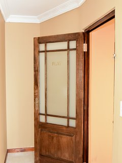 The flat door can be locked and latched on the inside.