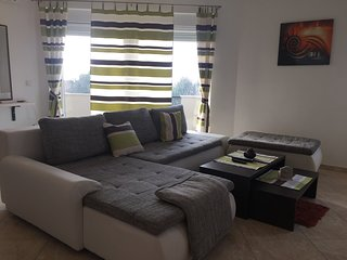 Spacious groundfloor apartment with private garden