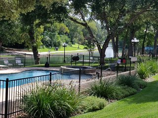 Riverfront Condo on the Comal River near Schlitterban Sleeps 6 - Just jump in!