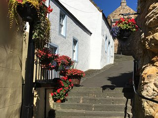 A delightful and historic property just a few steps from the harbour.