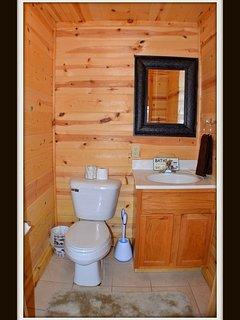 1/2 bathrrom - by laundry room - main level