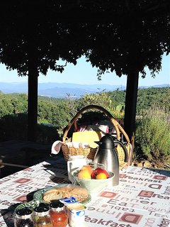 Breakfast is served under the pergola, whenever possible, to enjoy the great view of the valley