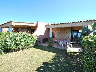 Villetta a schiera vista mare, con giardino privato in Res. con piscina comune