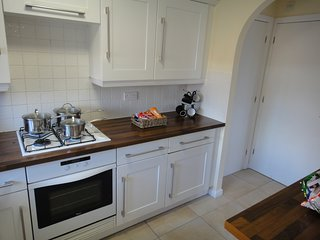 Kitchen with gas hob, electric oven and storage