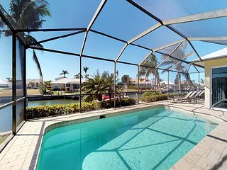 Waterfront 3 Bed Plus Den 3 Bath Home,Heated Pool w/ Large Screened-In Lanai!