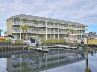 Waterfront 3BR w/ Private Boat Slip – Walk to Beach, Near Golf & Dining