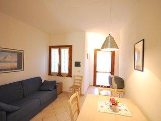 Appartamento con giardino recintato e barbecue in residence con piscina
