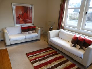 Modern & bright 2 bed/2 bath ground floor apartment with private parking