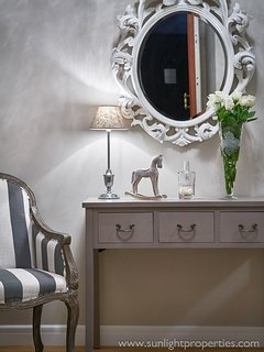 The elegant wall-mounted mirror sets the refined tone to come.