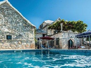 Pergola stone house with pool