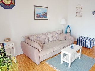 Cosy sofa bed in living area is waiting for you