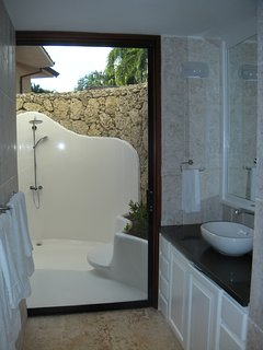Downstairs master has an outdoor shower in addition to indoor shower.