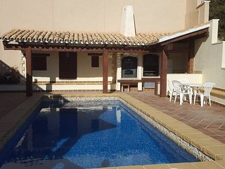 Pool with outside cooking area including pizza oven