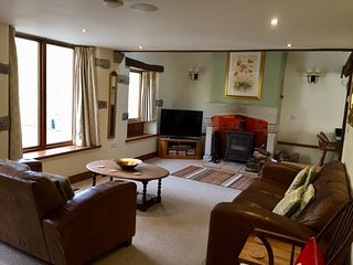 Large light lounge, overlooking river. Wood burner,Freeview TV, DVD player & fibre broadband