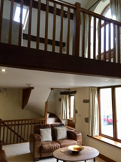 Showing mezzanine level from lounge. Giving house lovely spacious, light airy feel