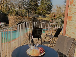Waterfall Cottage - beautiful stone cottage with swimming pools, tennis court