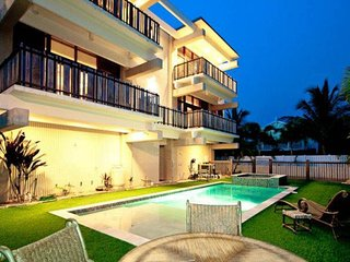 Modern home with pool and balconies - steps to Bean Point Beach, dogs OK!