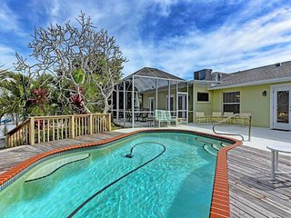 Spacious canal-front house with private pool & private dock - beaches nearby!