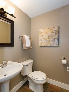 A modern half bathroom rounds out the entertaining floor of the home